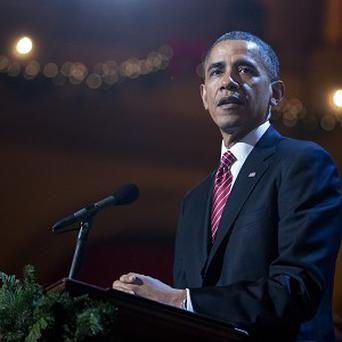 Concerns over surveillance online will be raised when Barack Obama meets technology CEOs (AP)