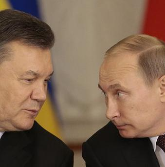 Vladimir Putin, right, and Viktor Yanukovych after their talks in Moscow (AP)