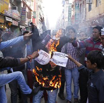 Indian Muslims burn an effigy of US president Barack Obama as they protest against the alleged mistreatment of a diplomat (AP)