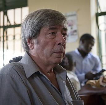 Briton Bernard Randall, 65, who is being charged in Uganda with trafficking in obscene publications, after police allegedly found pictures of him having gay sex. He denies the charge. (AP)