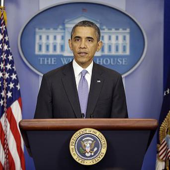 US President Barack Obama speaks during an end-of-the year news conference in the Brady Press Briefing Room at the White House (AP)