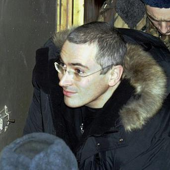 Former oil baron Mikhail Khodorkovsky is meeting his family in Berlin a day after being freed from a Russian prison (AP)