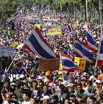 Thai anti-government protesters march in a Bangkok street (AP)