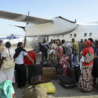 Kenyans return to Nairobi after being evacuated from violence-torn South Sudan by the Kenyan Air Force. (AP)
