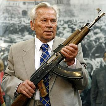 Mikhail Kalashnikov holds a prototype of his famous AK-47 assault rifle (AP)