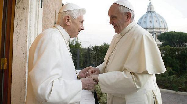 Pope Francis being greeted by his predecessor Pope Emeritus Benedict XVI. Photo: EPA/L'OSSERVATORE ROMANO