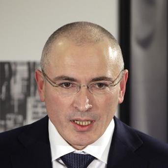 Freed Russian Mikhail Khodorkovsky has applied for a Swiss visa (AP)