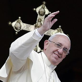 Pope Francis delivers his Christmas message from the central balcony of St Peter's Basilica at the Vatican (AP)