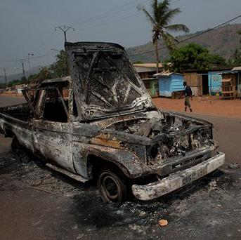 French soldiers stand guard around the burnt-out shell of a truck in Bangui, Central African Republic.