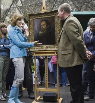 Fiona Bruce and Canon Jamie MacLeod with the Van Dyck painting on Antiques Roadshow.