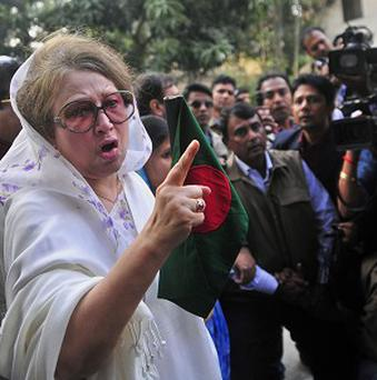Security officials surrounded the home of Bangladesh's former prime minister Khaleda Zia in Dhaka (AP)