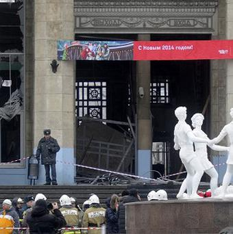 A police officer guards a main entrance to the Volgograd railway station hit by an explosion (AP)