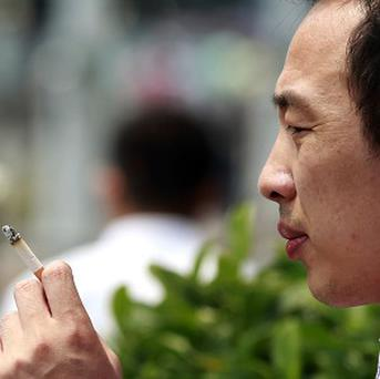 Chinese officials have been ordered to take the lead over the country's ban on smoking in public places