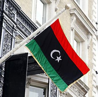 Attackers have killed a senior police officer and wounded his guard and another officer in Benghazi, Libya
