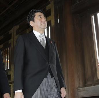 Japanese Prime Minister Shinzo Abe's visit to the Yasukuni shrine has angered China (AP)