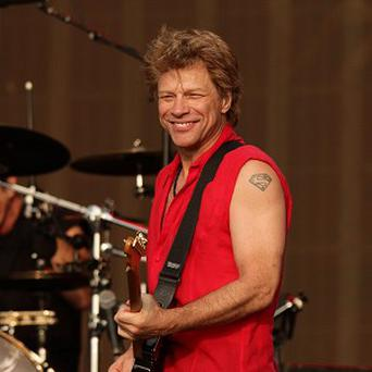 Jon Bon Jovi and his rock band have been named the highest-grossing tour of 2013.