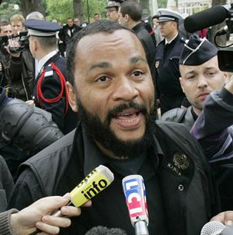 Paris prosecutors are investigating threats against controversial comic Dieudonne M'Bala M'Bala, whose alleged 'Nazi salute' gesture was copied by footballer Nicolas Anelka. (AP)