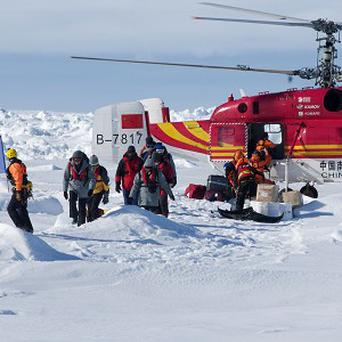 A Chinese helicopter rescued some of the 52 passengers trapped for more than a week on the icebound Russian research ship MV Akademik Shokalskiyin (AP/Australasian Antarctic Expedition)