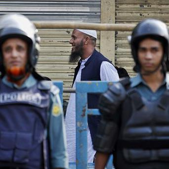 Policemen stand guard ahead of the general election in Bangladesh (AP)
