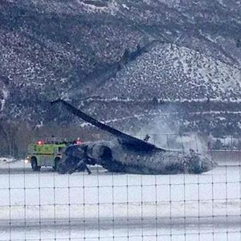 Emergency crews respond as a small plane lies on a runway at Aspen Airport in western Colorado (AP)