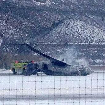 Emergency crews respond as a plane lies on a runway at Aspen airport, Colorado, after crash-landing. (AP)