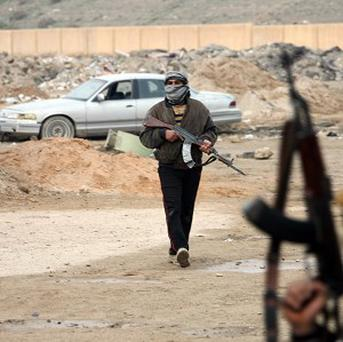 Gunmen on patrol after clashes with Iraqi security forces in Fallujah (AP)