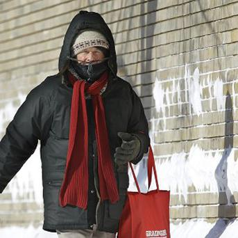 Jim Houston wraps up while heading to work in below zero temperatures in Springfield, Illinois.