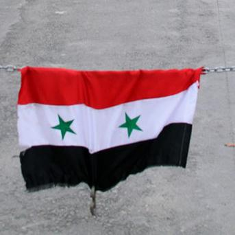 Activists say 10 people including children died in a Syrian government air strike in Bzaa