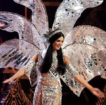 Former Miss Venezuela Monica Spear, who competed at the Miss Universe pageant in Thailand in 2005, was shot and killed by robbers, along with her husband Thomas Berry, a British citizen.