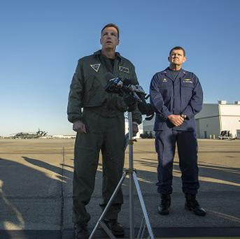 US Navy Commander Todd Flannery, left, said his 'heartfelt prayers go out to the families and loved ones of those killed and injured' (AP/The Virginian-Pilot)