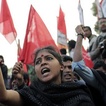 Bangladeshi activists shout slogans protesting against communal attacks during an ongoing strike called by the main opposition Bangladesh Nationalist Party in Dhaka (AP)