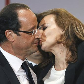 Francois Hollande kissing his companion, Valerie Trierweiler, after greeting crowds gathered to celebrate his election victory in Paris (AP)