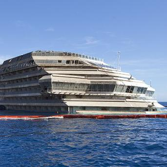 The Costa Concordia will be removed from its watery graveyard off Tuscany in June. (AP)