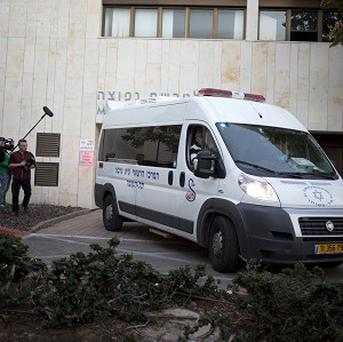 An ambulance carrying the body of late Prime Minister Ariel Sharon leaves the Sheba Medical Centre near Tel Aviv, Israel (AP)