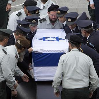 Members of the Knesset guard carry the coffin of former Israeli prime minister Ariel Sharon at the Knesset plaza, in Jerusalem (AP)