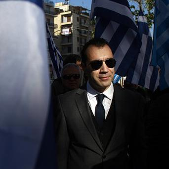 Golden Dawn MP Panagiotis Iliopoulos arrives at court in Athens to testify to prosecutors