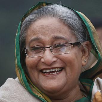 Bangladesh Prime Minister Sheikh Hasina has vowed to uphold democracy after an election marred by violence