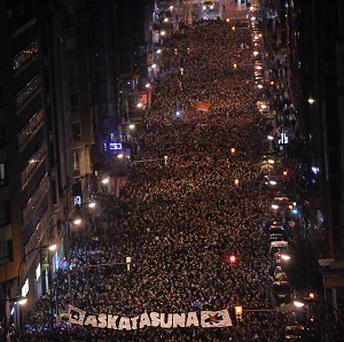 Pro-independence Basque demonstrators gather on the street during the protest in Bilbao (AP)