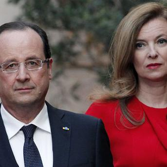 Valerie Trierweiler is in hospital for 'rest and tests' after claims her partner, French President Francois Hollande, left, is having an affair