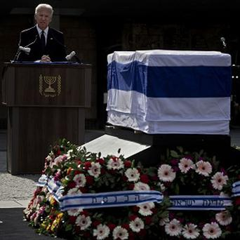 US vice president Joe Biden gives a speech next to the coffin of late Israeli Prime Minister Ariel Sharon at the Knesset, the Israeli Parliament, in Jerusalem