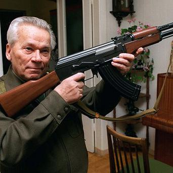 Mikhail Kalashnikov with his world-famous AK-47 assault rifle (AP)