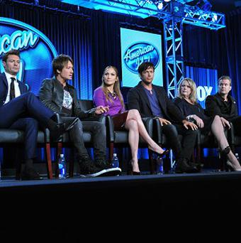 From left, American Idol host Ryan Seacrest, judges Keith Urban, Jennifer Lopez and Harry Connick Jr, and executive producers Trish Kinane and Per Blankens (Invision/AP)