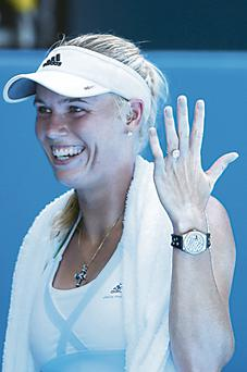 Tennis star Caroline Wozniacki delighted fans by showing off her dazzling eight-carat diamond engagement ring at the Australian Open.