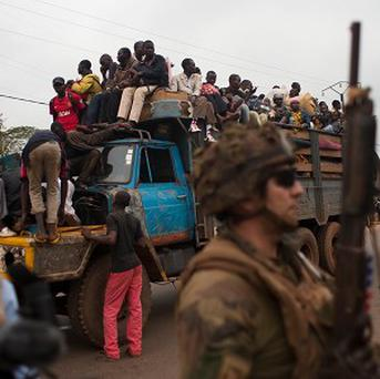 French soldiers protect a lorry-load of fleeing Muslims in the Gobongo neighbourhood of Bangui, Central African Republic (AP)