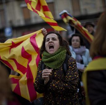 "People hold ""estelada"" flags and shout slogans during a pro-independence event in Barcelona (AP)"