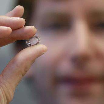 Google X project lead Brian Otis holds a contact lens being tested to explore tear glucose (AP)