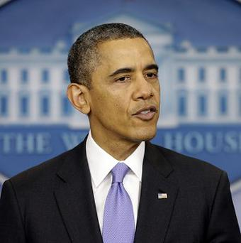Barack Obama says the US is not spying on ordinary citizens who don't threaten national security (AP)