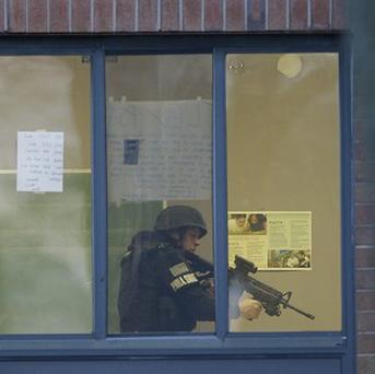 Police search a school in Philadelphia following a shooting. (AP)