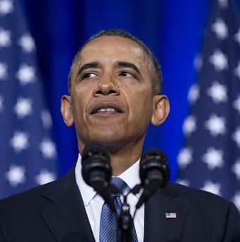 President Barack Obama's mother was the subject of a racist email sent by a former US judge (AP)