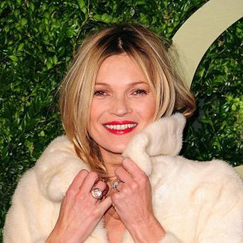 Playboy is suing the publisher of Harper's Bazaar magazine over online photos of supermodel Kate Moss